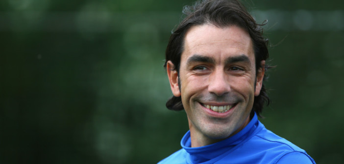 ST ALBANS, ENGLAND - SEPTEMBER 30:  Robert Pires looks on during an Arsenal training session ahead of their Champions League Group F match against Napoli at London Colney on September 30, 2013 in St Albans, England.  (Photo by Paul Gilham/Getty Images)