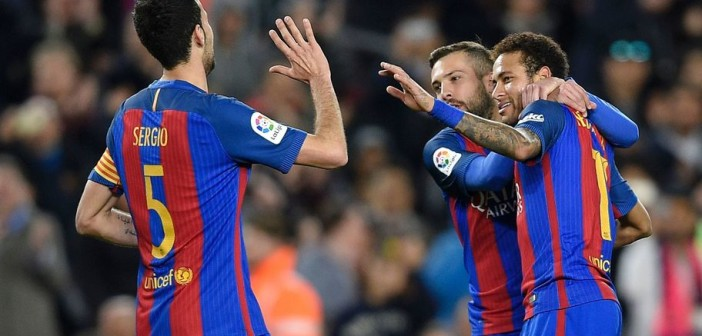Barcelona's Brazilian forward Neymar (R) celebrates with Barcelona's defender Jordi Alba (C) and Barcelona's midfielder Sergio Busquets after scoring during the Spanish league football match FC Barcelona vs Real Sporting de Gijon at the Camp Nou stadium in Barcelona on March 1, 2017. / AFP PHOTO / LLUIS GENE        (Photo credit should read LLUIS GENE/AFP/Getty Images)