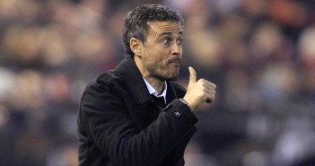 Barcelona's head coach Luis Enrique gestures to the players during a Spanish La Liga soccer match against Valencia at the Mestalla stadium in Valencia, Spain, Saturday, Dec. 5, 2015. (AP Photo/Alberto Saiz)