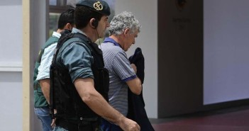 Spanish Gaurdia Civil escort president of the Spanish Football Federation, Angel Maria Villar (R) on arrival to the Spanish football federation headquarters in Madrid on July 18, 2017 during a raid related to the probe said that Villar is suspected of staging international football matches as part of a scheme to embezzle profits for the benefit of his son. The president of the Spanish Football Federation, Angel Maria Villar, was detained by police today as part of a corruption probe, a judicial source said. Villar's son Gorka and another federation official were also detained in the probe which notably focuses on allegations of skimming profits from international matches, the source told AFP. / AFP PHOTO / PIERRE-PHILIPPE MARCOU