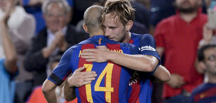 Barcelona's Croatian midfielder Ivan Rakitic (R) celebrates a goal with teammate Barcelona's Argentinian defender Javier Mascherano during the Spanish league football match FC Barcelona vs Club Atletico de Madrid at the Camp Nou stadium in Barcelona on September 21, 2016. / AFP / JOSEP LAGO        (Photo credit should read JOSEP LAGO/AFP/Getty Images)
