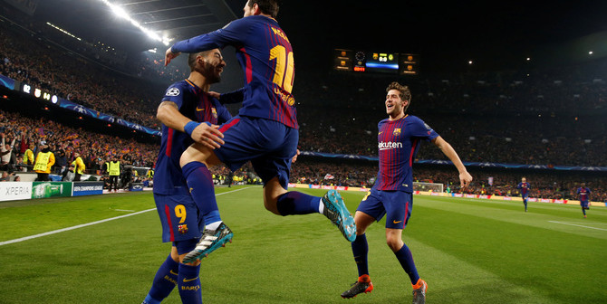 Soccer Football - Champions League Round of 16 Second Leg - FC Barcelona vs Chelsea - Camp Nou, Barcelona, Spain - March 14, 2018   Barcelona's Lionel Messi celebrates scoring their first goal with Luis Suarez     REUTERS/Susana Vera - RC19098F1CC0