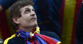 FC Barcelona's coach Tito Vilanova looks on as he celebrates his team's victory after winning the Spanish league soccer title during a bus tour through Barcelona city, Spain, Monday, May 13, 2013.