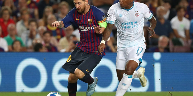 Soccer Football - Champions League - Group Stage - Group B - FC Barcelona v PSV Eindhoven - Camp Nou, Barcelona, Spain - September 18, 2018  Barcelona's Lionel Messi in action with PSV Eindhoven's Steven Bergwijn   REUTERS/Sergio Perez - RC13AB2F8B10