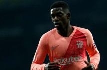 Barcelona's French forward Ousmane Dembele runs during the Spanish league football match RCD Espanyol against FC Barcelona at the RCDE Stadium in Cornella de Llobregat on December 8, 2018. (Photo by PAU BARRENA / AFP)