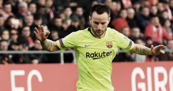 GIRONA, SPAIN - JANUARY 27:  Pere Pons of Girona is challenged by Ivan Rakitic of Barcelona during the La Liga match between Girona FC and FC Barcelona at Montilivi Stadium on January 27, 2019 in Girona, Spain.  (Photo by David Ramos/Getty Images)