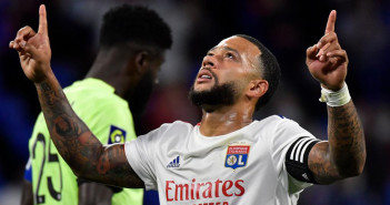 Lyon's Dutch forward Memphis Depay celebrates after scoring a goa during the French L1 footall match between Olympique Lyonnais (OL) and Dijon FC on August 28, 2020, at the Groupama Stadium in Decines-Charpieu, near Lyon, central-eastern France. (Photo by Philippe DESMAZES / AFP)