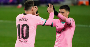 Barcelona's Argentine forward Lionel Messi (L) celebrates with Barcelona's Spanish midfielder Pedri after scoring a goal during the Spanish league football match between Real Valladolid FC and FC Barcelona at the Jose Zorilla stadium in Valladolid on December 22, 2020. (Photo by Cesar Manso / AFP)